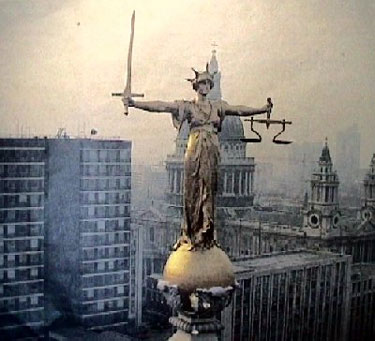 Justice on top of Old Bailey London, England